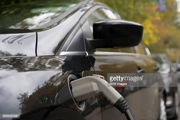 Charging an electric car, close-up