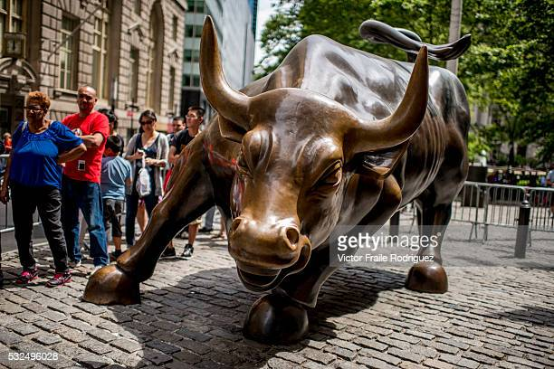Charging Bull by Arturo Di Modica near Wall Street Stock Exchange on June 17 2012 in New York United States of America Photo by Victor Fraile