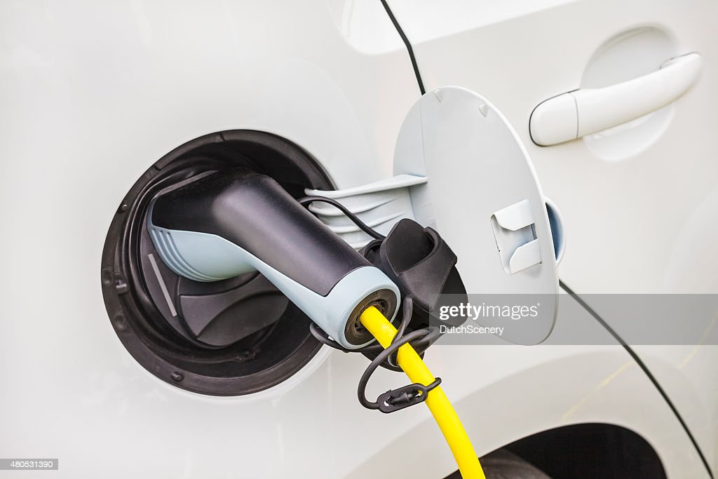 Charging of an electric car : Stock Photo