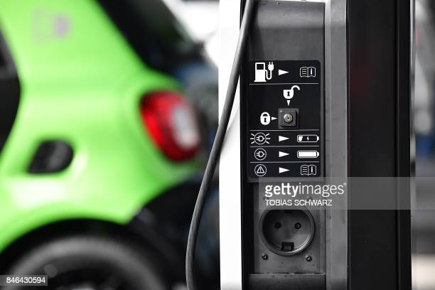 A charging panel is pictured at a loading station for electric cars at the Frankfurt Auto Show IAA in Frankfurt am Main central Germany on September...