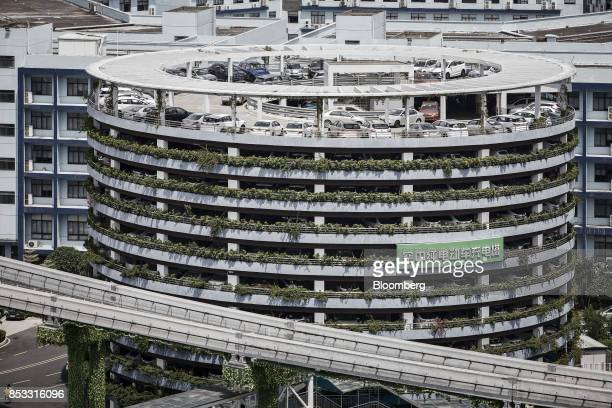 A charging parking lot tower stands at the BYD Co headquarters in Shenzhen China on Thursday Sept 21 2017 China will likely order an end to sales of...