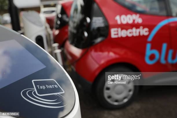 A charging plug connects an electric vehicle to a charging station on August 17 2017 in London England A study commissioned by power generation...