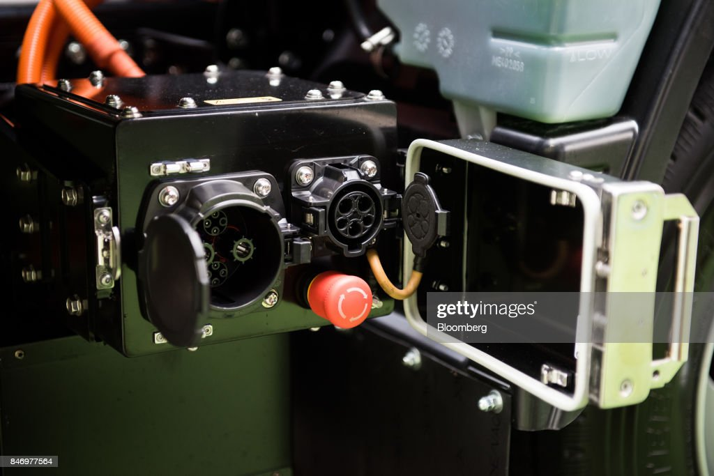A charging port for the Mitsubishi Fuso eCanter truck is seen during a launch event in New York, U.S., on Thursday, Sept. 14, 2017. The Daimler AG unit unveiled the new Fuso eCanter, an electric light-duty truck produced under its Mitsubishi Fuso brand. The latest version has a range of 60 to 80 miles (97 to 129 kilometers) between charges, depending on body, load and usage. Photographer: Mark Kauzlarich/Bloomberg via Getty Images