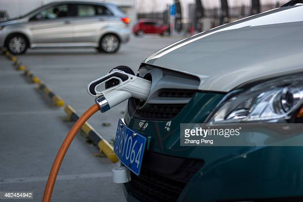 A charging station for electric cars To fight the 'war on pollution' Chinese government is increasing public and private charging facilities to...