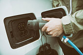 Male Hand Charging The Electric Car