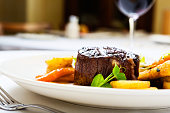 Char-grilled filet  mignon with glazed vegetables