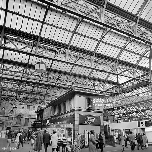 Charing Cross Station London 19601972 Passengers on the station concourse outside platform 5 with a branch of Boots the chemist