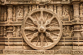 A chariot wheel carved into the temple wall at Konark, India.