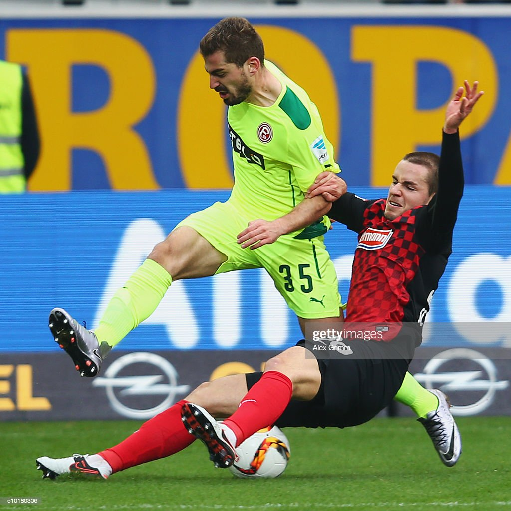 Charis Mavrias of Duesseldorf is challenged by Christian Guenter of Freiburg during the Second Bundesliga match between SC Freiburg and Fortuna Duesseldorf at Schwarzwald-Stadion on February 14, 2016 in Freiburg im Breisgau, Germany.