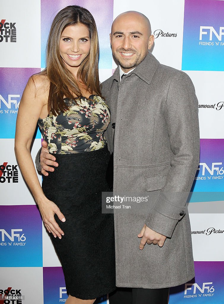 Charisma Carpenter and Mike Rossi arrive at the 16th Annual 'Friends And Family' pre-GRAMMY event held at Paramount Studios on February 8, 2013 in Hollywood, California.