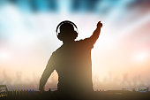 Charismatic disc jockey. Club, disco DJ playing and mixing music for crowd people.
