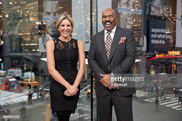 Charissa Thompson interviews Steve Harvey during his visit to 'Extra' at their New York studios at HM in Times Square on February 9 2015 in New York...