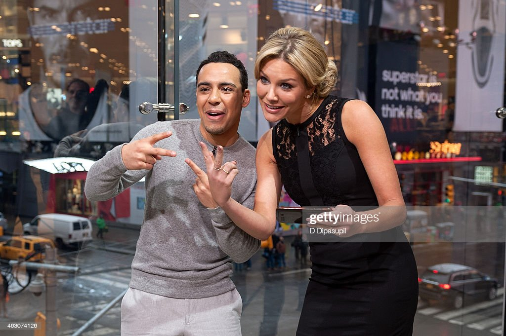 Charissa Thompson (R) interviews Victor Rasuk during his visit to 'Extra' at their New York studios at H&M in Times Square on February 9, 2015 in New York City.