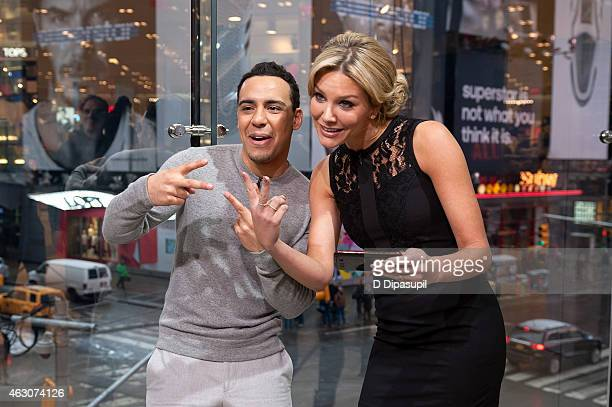 Charissa Thompson interviews Victor Rasuk during his visit to 'Extra' at their New York studios at HM in Times Square on February 9 2015 in New York...