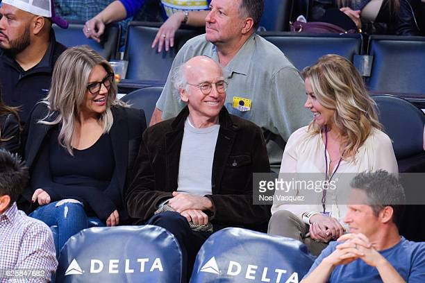 Charissa Thompson Larry David and Jeanie Buss attend a basketball game between the Golden State Warriors and the Los Angeles Lakers at Staples Center...