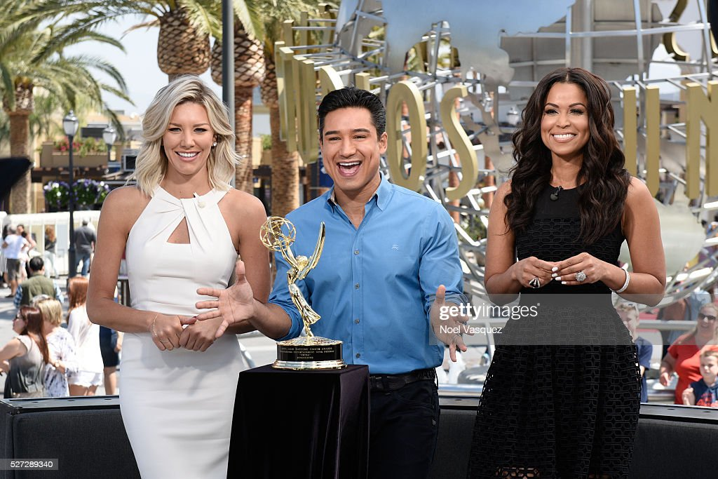 Charissa Thompson, Mario Lopez and Tracey Edmonds celebrate with their Day Time Emmy at 'Extra' at Universal Studios Hollywood on May 2, 2016 in Universal City, California.