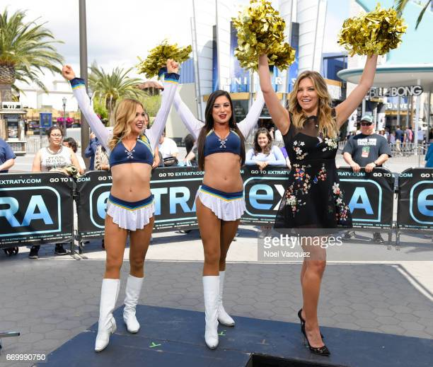 Charissa Thompson poses with the Los Angeles Chargers visits 'Extra' at Universal Studios Hollywood on April 18 2017 in Universal City California