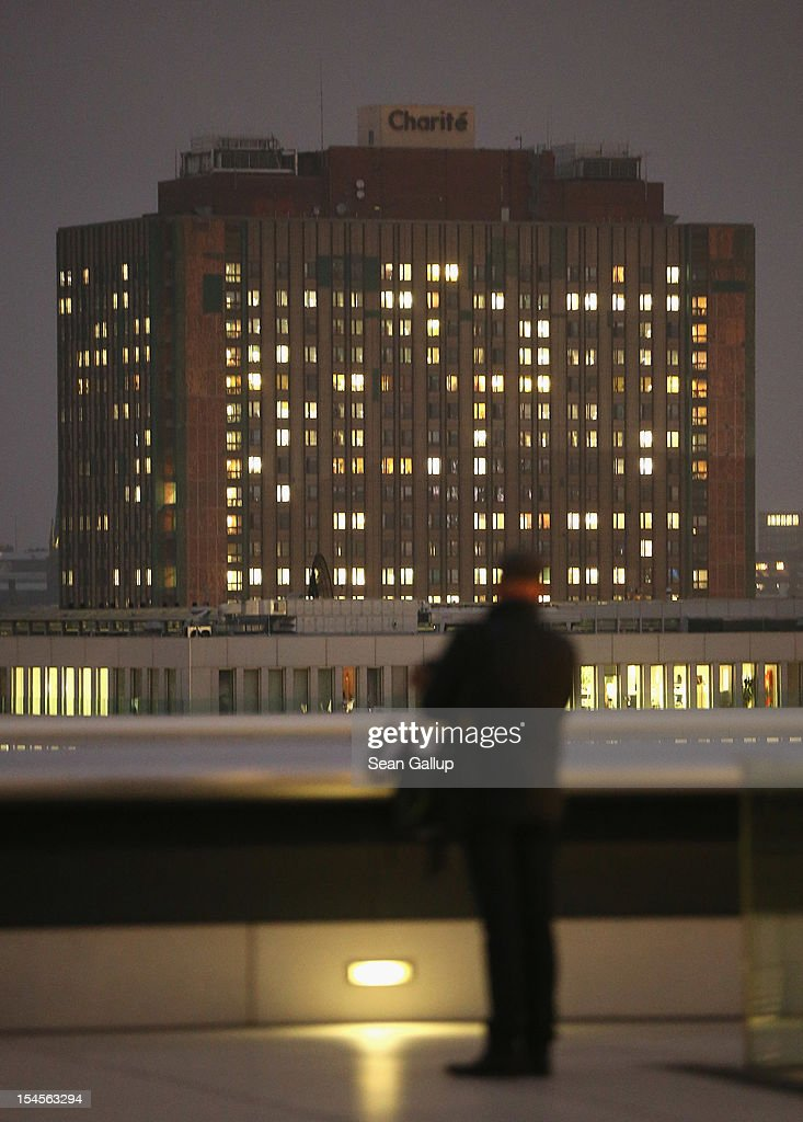Charite hospital looms behind a man visiting the terrace of the Reichstag two days after Charite officials announced an early-born infant died of an infection at the Charite Virchow campus on October 22, 2012 in Berlin, Germany. Hospital officials announced the infant died two weeks ago of a bacterial infection and that seven other infants are ill but in stabile condition. Health authorities are investigating. Germany has seen a string of infant deaths in the last year nationwide due to poor hygiene at several hospitals and clinics.