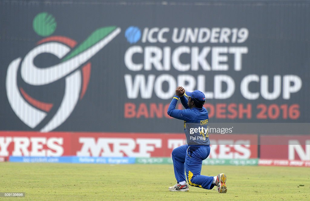 Charith Asalanka of Sri Lanka takes a catch to get Arman Jaffer of India(not in the photo) out during the ICC U19 World Cup Semi-Final match between India and Sri Lanka on February 9, 2016 in Dhaka, Bangladesh.