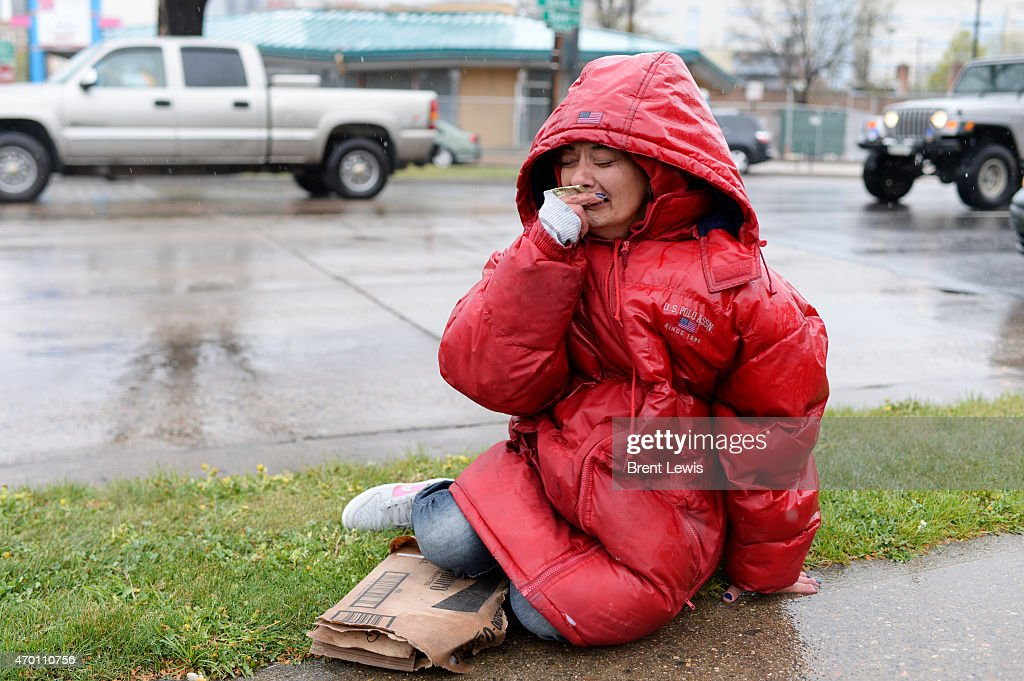 Charity Martinez cries after getting $20 from a driver passing by Thursday April 16 2015 at Colfax Avenue and Speer Boulevard in Denver Colorado...