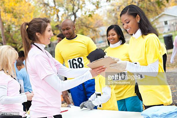 Charity race runner filling out forms at the event