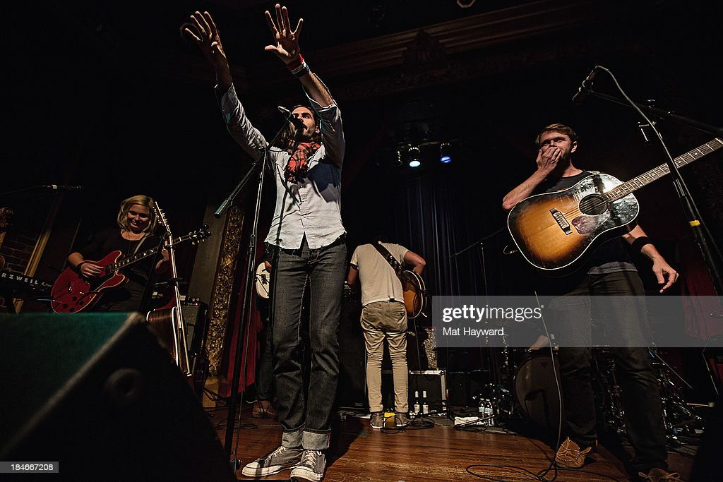 Charity Rose Thielen, Jonathan Russell and Josiah Johnson of Head and the Heart perform on stage at Columbia City Theater on October 14, 2013 in Seattle, Washington.