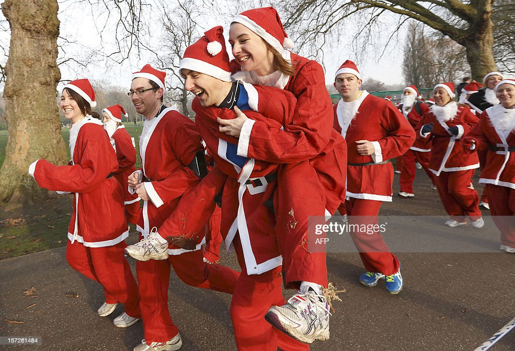 Charity runners dressed as Father Christmas participate in a 'Santa Run' charity fun run in Battersea Park in London on December 1, 2012. Hundreds of participants dressed in Santa suits and white beards ran through Battersea park in aid of winter sports charity Disability Snowsport in this 6km festive fun run.