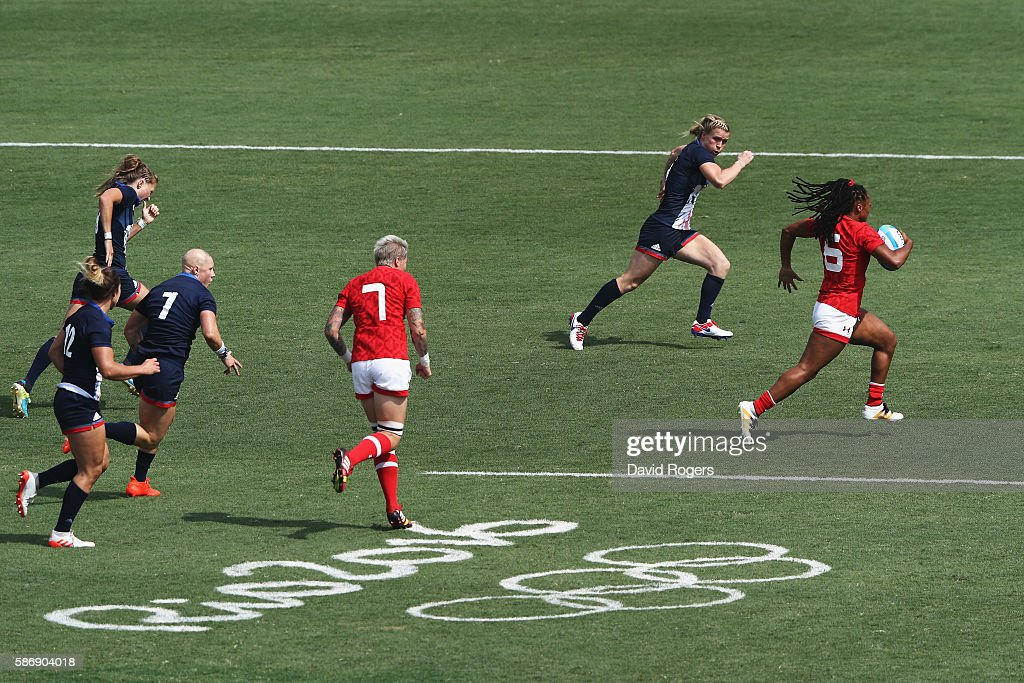 Charity Williams of Canada carries the ball against Great Britain during the Women's Pool C rugby match on Day 2 of the Rio 2016 Olympic Games at...