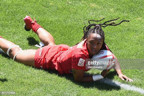 Charity Williams of Canada scores a try during the HSBC World Rugby Women's Sevens Series 2016/17 Kitakyushu quarter final between Canada and Russia...
