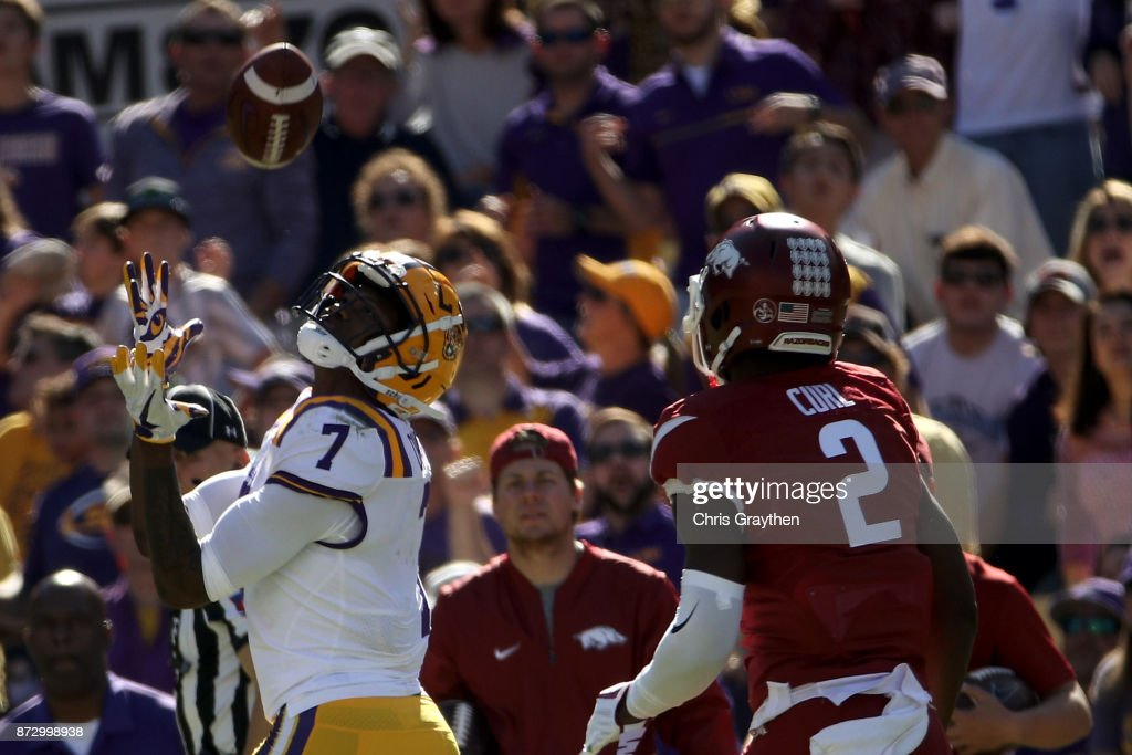 D.J. Chark #7 of the LSU Tigers catches a touchdown pass over Kamren Curl #2 of the Arkansas Razorbacks at Tiger Stadium on November 11, 2017 in Baton Rouge, Louisiana.
