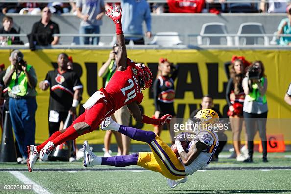 J Chark of the LSU Tigers makes a 39yard reception behind Zykiesis Cannon of the Louisville Cardinals to set up a touchdown in the second quarter of...