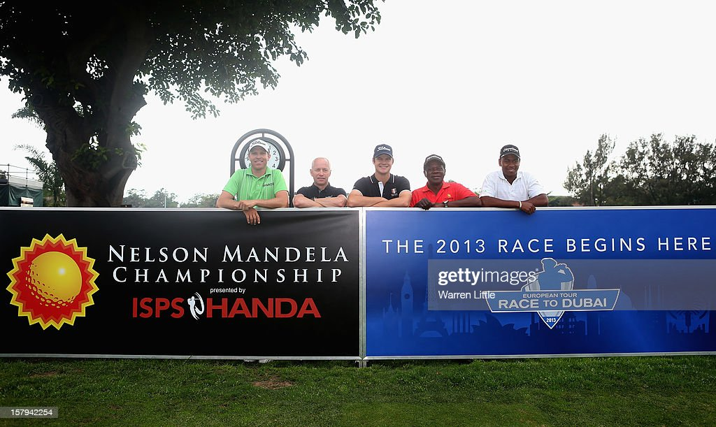 Charl Coetzee of South Africa, Mikael Eriksson, European Tour Tournament Director, Espen Kofstad of Norway,Theo Manyama, Tournament Director of the Sunshine Tour and Thabo Maseko of South Africa pose ahead of the first tee shot to start the 2013 Race to Dubai during the first round of The Nelson Mandela Championship presented by ISPS Handa at Royal Durban Golf Club on December 8, 2012 in Durban, South Africa.