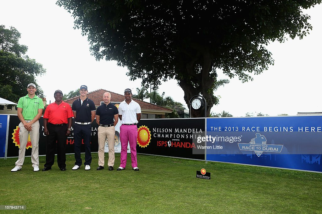 Charl Coetzee of South Africa, Theo Manyama, Tournament Director of the Sunshine Tour, Espen Kofstad of Norway, Mikael Eriksson, European Tour Tournament Director and Thabo Maseko of South Africa pose ahead of the first tee shot to start the 2013 Race to Dubai during the first round of The Nelson Mandela Championship presented by ISPS Handa at Royal Durban Golf Club on December 8, 2012 in Durban, South Africa.