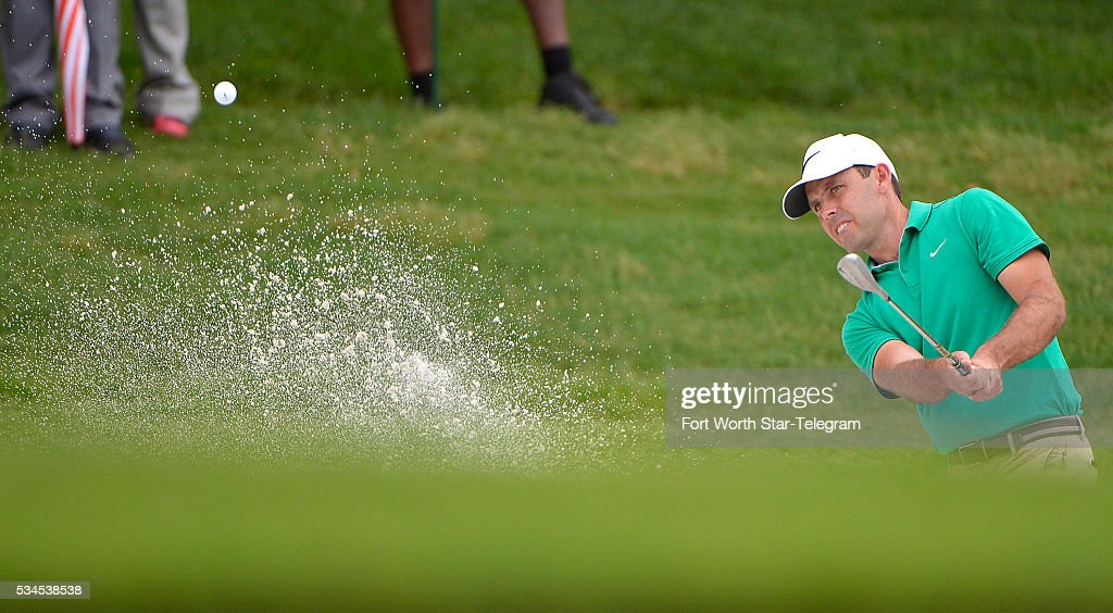 Charl Schwartzel hits out of a fairway bunker on the 1st hole during the first round of the Dean & DeLuca Invitational at Colonial Country Club in Fort Worth, Texas, on Thursday, May 26, 2016.
