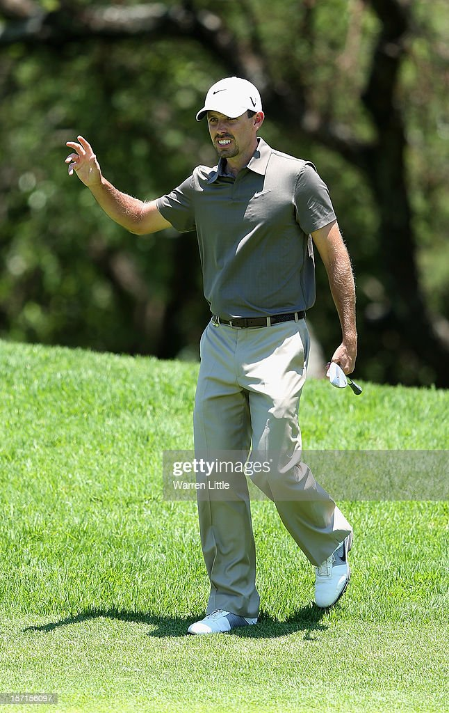 Charl Schwartzel of South Africa acknowledges the crowd after chipping in for a birdie on the fourth hole during the first round of the Nedbank Golf Challenge at the Gary Player Country Club on November 29, 2012 in Sun City, South Africa.
