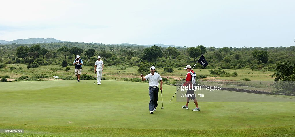<a gi-track='captionPersonalityLinkClicked' href=/galleries/search?phrase=Charl+Schwartzel&family=editorial&specificpeople=213793 ng-click='$event.stopPropagation()'>Charl Schwartzel</a> of South Africa acknowledges the crowd on the 13th green during the final round of the Alfred Dunhill Championship at Leopard Creek Country Golf Club on December 16, 2012 in Malelane, South Africa.