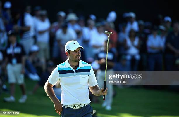 Charl Schwartzel of South Africa acknowledges the crowd on the 18th green during the third round of the South African Open Championship at Glendower...