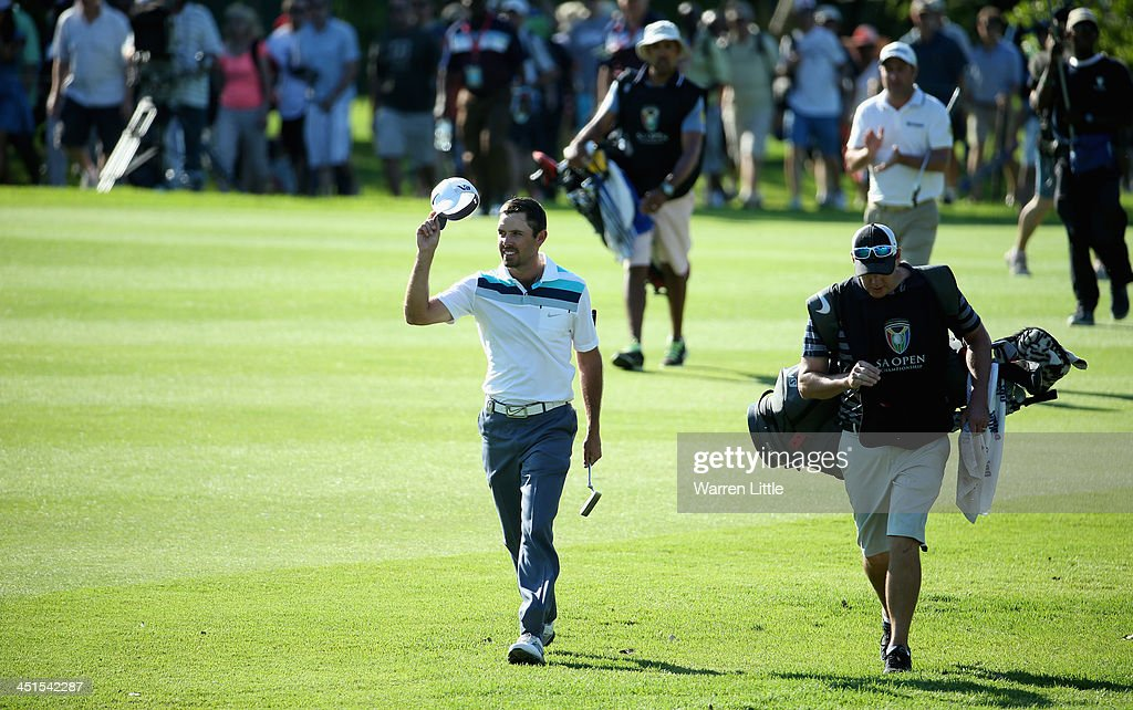 <a gi-track='captionPersonalityLinkClicked' href=/galleries/search?phrase=Charl+Schwartzel&family=editorial&specificpeople=213793 ng-click='$event.stopPropagation()'>Charl Schwartzel</a> of South Africa acknowledges the crowd on the 18th hole during the third round of the South African Open Championship at Glendower Golf Club on November 23, 2013 in Johannesburg, South Africa.