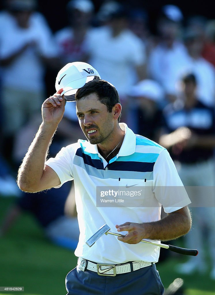<a gi-track='captionPersonalityLinkClicked' href=/galleries/search?phrase=Charl+Schwartzel&family=editorial&specificpeople=213793 ng-click='$event.stopPropagation()'>Charl Schwartzel</a> of South Africa acknowledges the crowd on the 18th green during the third round of the South African Open Championship at Glendower Golf Club on November 23, 2013 in Johannesburg, South Africa.