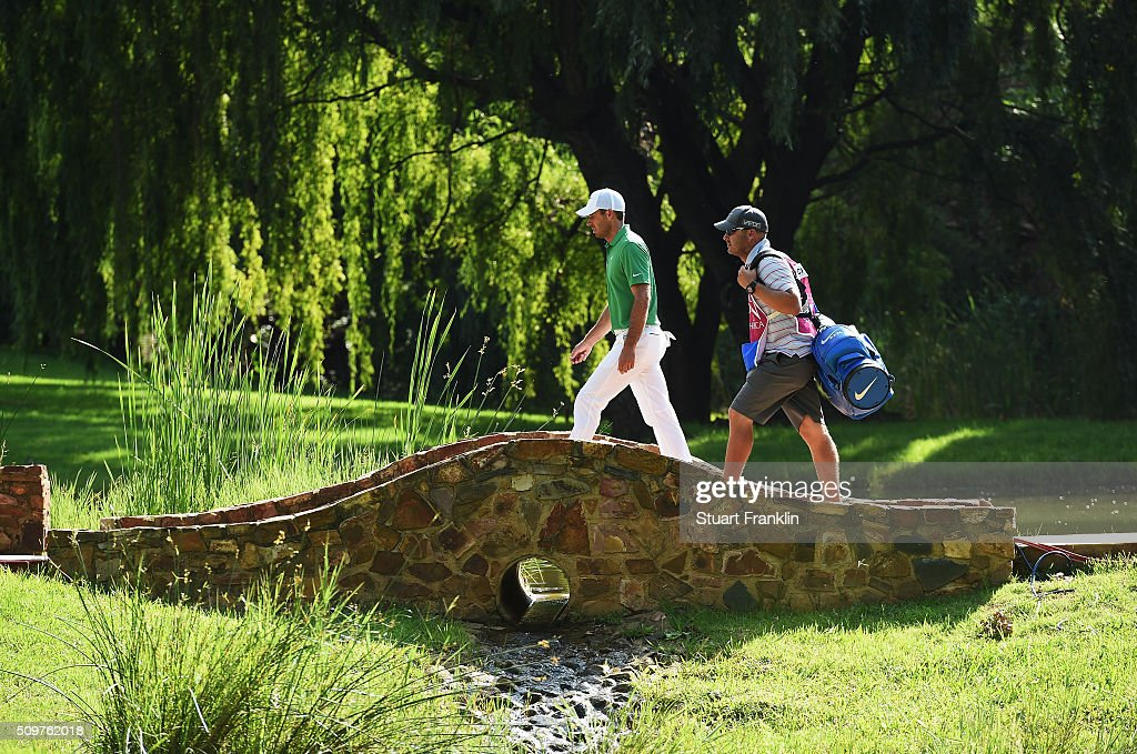 <a gi-track='captionPersonalityLinkClicked' href=/galleries/search?phrase=Charl+Schwartzel&family=editorial&specificpeople=213793 ng-click='$event.stopPropagation()'>Charl Schwartzel</a> of South Africa and caddie walk over a bridge during the second round of the Tshwane Open at Pretoria Country Club on February 12, 2016 in Pretoria, South Africa.