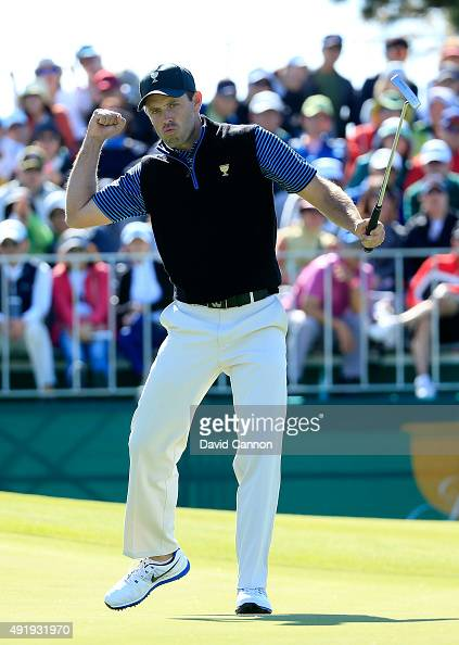 Charl Schwartzel of South Africa and the International Team celebrates as he holes a birdie putt to win the hole on the 13th green in his match with...