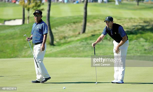 Charl Schwartzel of South Africa and the International Team lines up an eagle putt on the third hole in his match with Thongchai Jaidee against Bill...