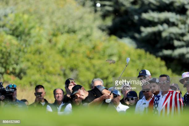Charl Schwartzel of South Africa and the International team plays his second shot on the first hole in his match against Matt Kuchar of the United...