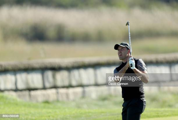 Charl Schwartzel of South Africa and the International team plays his second shot on the 14th hole in his match against Matt Kuchar of the United...