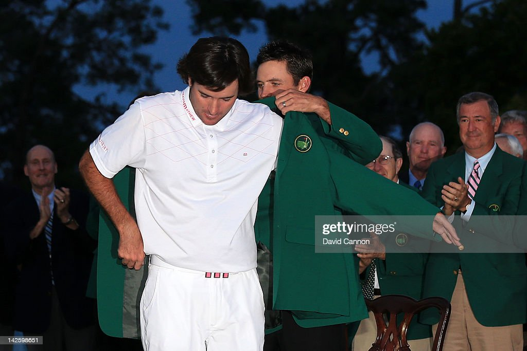 <a gi-track='captionPersonalityLinkClicked' href=/galleries/search?phrase=Charl+Schwartzel&family=editorial&specificpeople=213793 ng-click='$event.stopPropagation()'>Charl Schwartzel</a> of South Africa awards the green jacket to <a gi-track='captionPersonalityLinkClicked' href=/galleries/search?phrase=Bubba+Watson&family=editorial&specificpeople=597658 ng-click='$event.stopPropagation()'>Bubba Watson</a> (R) of the United States during the green jacket presentation after Watson's one-stroke to win the 2012 Masters Tournament at Augusta National Golf Club on April 8, 2012 in Augusta, Georgia.