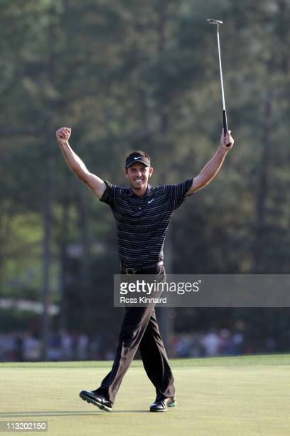 Charl Schwartzel of South Africa celebrates his birdie on the 18th green and winning the Masters during the final round of the 2011 Masters...