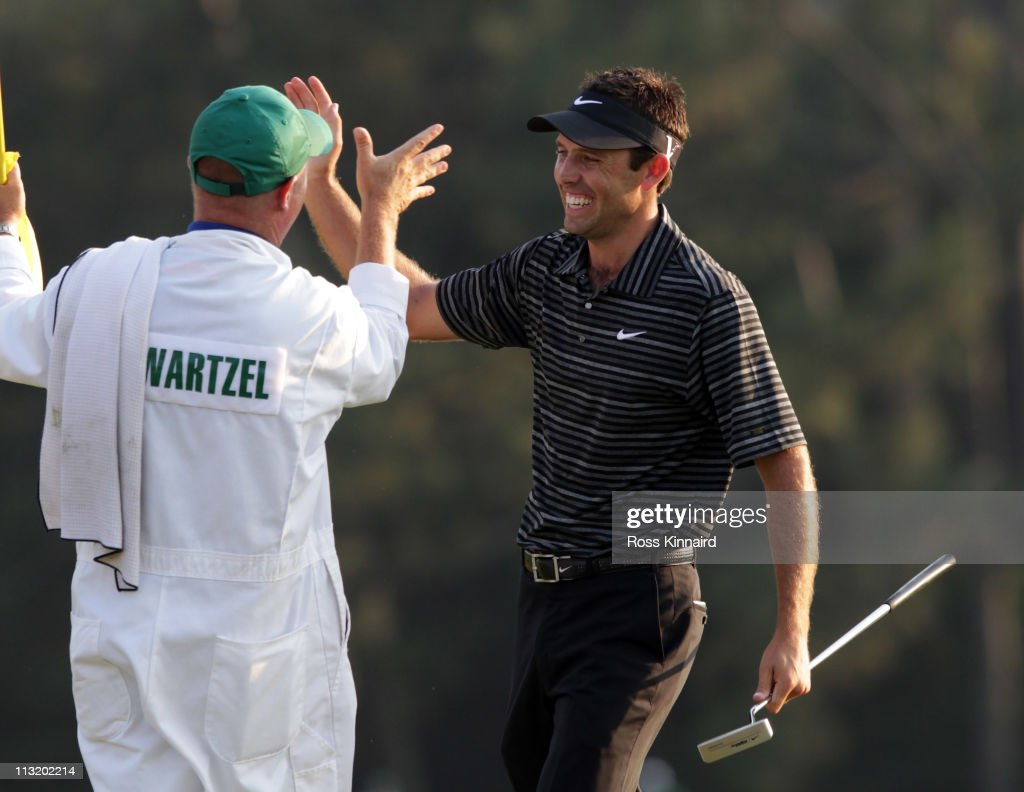 Charl Schwartzel of South Africa celebrates his birdie on the 18th green with his caddie Greg Hearmon and winning the Masters during the final round of the 2011 Masters Tournament at Augusta National Golf Club on April 10, 2011 in Augusta, Georgia.