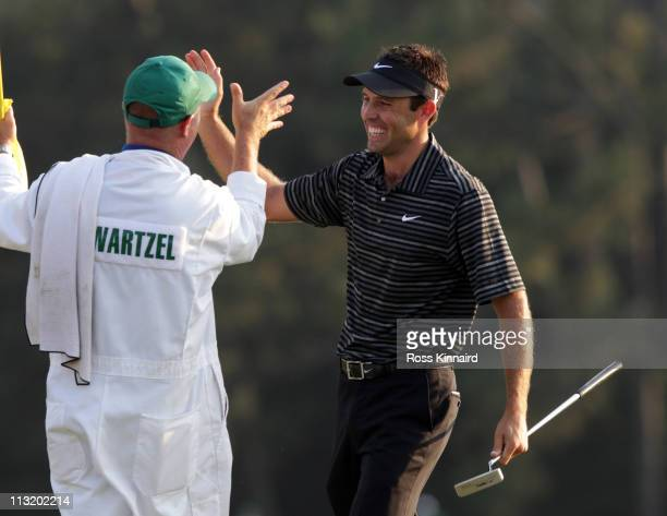 Charl Schwartzel of South Africa celebrates his birdie on the 18th green with his caddie Greg Hearmon and winning the Masters during the final round...