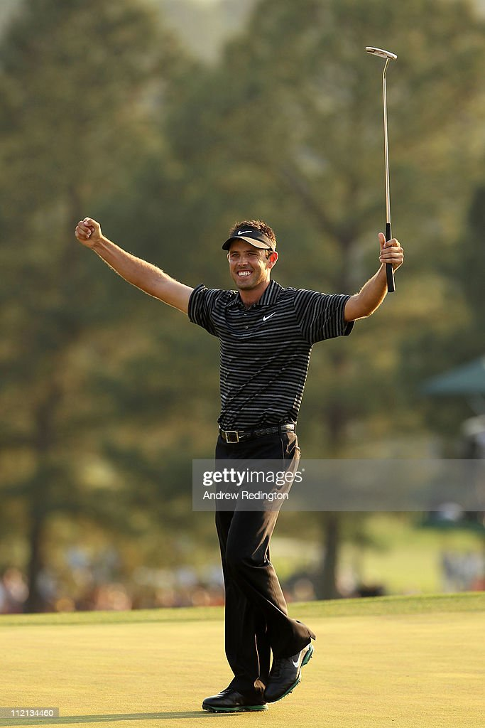 Charl Schwartzel of South Africa celebrates his two-stroke victory at the 2011 Masters Tournament at Augusta National Golf Club on April 10, 2011 in Augusta, Georgia.