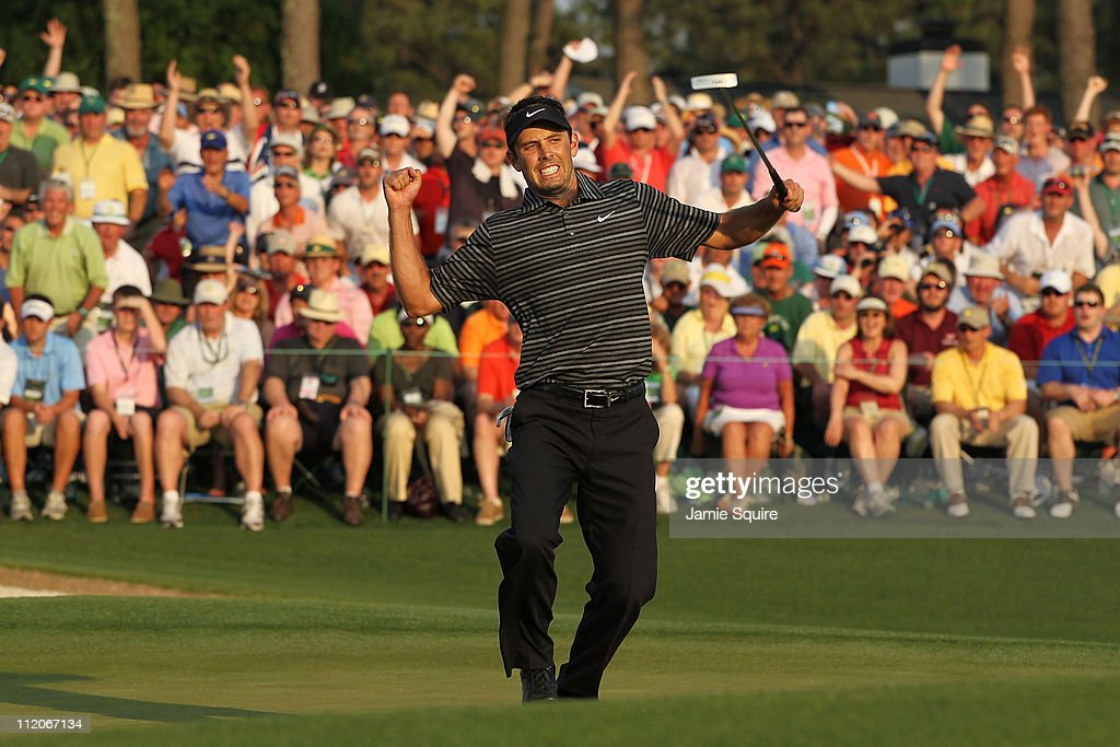 Charl Schwartzel of South Africa celebrates his two-stroke victory on the 18th green during the final round of the 2011 Masters Tournament at Augusta National Golf Club on April 10, 2011 in Augusta, Georgia.